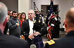Bagpiper Marty Petrie leads an honor guard of Belleville firefighters and police officers as they present the colors at the start of the ceremony. The city of Belleville held their 21st annual Veterans Day ceremony inside Belleville City Hall on Thursday November 11, 2019. It was moved inside due to the winter weather.<br /> Photo by Tim Vizer
