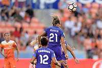 Houston, TX - Saturday June 17, 2017: Monica Hickmann Alves heads the ball away from her goal during a regular season National Women's Soccer League (NWSL) match between the Houston Dash and the Orlando Pride at BBVA Compass Stadium.