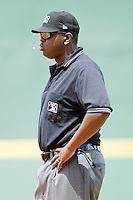 First base umpire Art Thigpen spits out a sunflower seed during the International League game between the Louisville Bats and the Charlotte Knights at Knights Stadium on July 17, 2011 in Fort Mill, South Carolina.  The Knights defeated the Bats 7-6.   (Brian Westerholt / Four Seam Images)