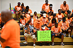 People who had walked in the Wear Orange Day March against gun violence bow their heads during a prayer by Rev. Ralph Shannon (left) at the rally and resource fair held at the Herbert Hoover Boys & Girls Club after the march on Saturday June 2, 2018. Shannon is the outreach pastor at the Friendly Temple Missionary Baptist Church. June is National Gun Violence Awareness Month.<br /> Photo by Tim Vizer