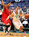 SIOUX FALLS, SD - MARCH 5:  Mychel Thompson #17 from the Sioux Falls Skyforce gets a step past Jason Ellis #21 from the Idaho Stampede in the first half of their game Tuesday night at the Sioux Falls Arena. (Photo by Dave Eggen/Inertia)