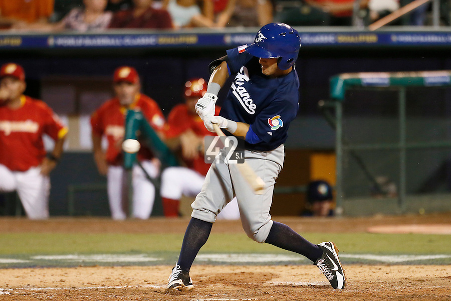 20 September 2012: Maxime Lefevre hits the ball during Spain 8-0 win over France, at the 2012 World Baseball Classic Qualifier round, in Jupiter, Florida, USA.