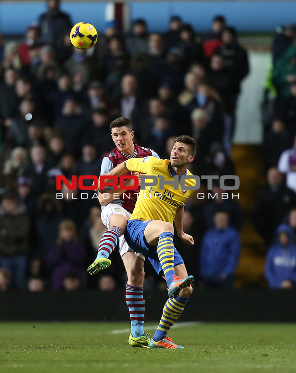 Aston Villa's Ciaran Clark clears under pressure from Arsenal's Olivier Giroud -  13/01/2014 - SPORT - FOOTBALL - Villa Park - Birmingham - Aston Villa v Arsenal - Barclays Premier League<br /> Foto nph / Meredith<br /> <br /> ***** OUT OF UK *****