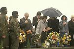 "Bobby Sands ""Robert Gerard Sands"" funeral  his mother in pale coat, wife Geraldine Noade with hands to head of their son Gerard who looks down. 1981 Milltown cemetery Northern Ireland UK"