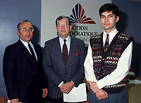 Unknown (L)<br /> Jean Allaire (M), leader<br /> Mario Dumont (R)	<br /> Action démocratique du Québec (ADQ)<br /> in March 1994<br /> <br /> This party was founded in 1994 by Québec LIBERAL PARTY dissidents. After the rejection of the CHARLOTTETOWN ACCORD in October 1992, Mario Dumont, leader of the Young Liberals of Québec, and Jean Allaire a member of the executive committee of the Québec Liberal Party, left the Liberal Party when its members decided not to defend their platform proposition of 22 fields of exclusive jurisdiction claimed on behalf of Québec.<br /> <br /> The dissidents formed an initial amalgamation, le groupe de Réflexion Québec, followed in December 1993 by Action Québec. The (ADQ) party was founded only the following year, placing Mario Dumont, 23, the youngest party leader in Québec, at its head. The ADQ presented its first electoral platform on 5 and 6 March 1994, when 612 delegates from all the Québec regions adopted a Plan national de redressement (National recovery plan), bearing some twenty propositions aimed at elaborating an economic strategy and stabilizing government finances.<br /> <br /> In the September 1994 elections, the ADQ elected only a single candidate, Mario Dumont, in Rivière-du-Loup, but still obtained nearly 10 percent support of Quebec voters, even if it did not present candidates in all the electoral districts.<br /> <br /> In June 1995, Mario Dumont, Lucien BOUCHARD, then leader of the BLOC QU?B?COIS, and Jacques PARIZEAU, leader of the PARTI QU?BECOIS, signed an agreement that united these three parties within the Yes camp and partnered them for the formulation of the referendum question (see QU?BEC REFERENDUM 1995).<br /> <br /> In the 30 November 1998 elections, only Mario Dumont was elected, again in Rivière-du-Loup, if the ADQ increased its percentage of support, by about 500 000 votes. The ADQ did not succeed in passing the critical voting threshold of 15 percent, making it a third party. However, the ADQ fought for proportional representation in the NATIONAL ASSEMBLY. Bringing toge