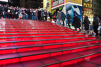 "New York, NY -  21 December 2012 Over 500 people filled the red steps in Times Square to join to sing Lennon's song ""Imagine""  Several hundred more gathered in the mall of Duffy Square to sing along...The song was lead by Thomas McCarger, conductor and singer, and under the auspices of Make Music New York, while IMAGINE PEACE lit up the Times Square billboards at 11:57 p.m."