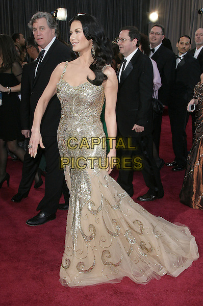 Catherine Zeta-Jones (wearing Zuhair Murad).85th Annual Academy Awards held at the Dolby Theatre at Hollywood & Highland Center, Hollywood, California, USA..February 24th, 2013.oscars full length silver gold beige tulle metallic dress hand arm profile sequins sequined beads beaded .CAP/ADM.©AdMedia/Capital Pictures.