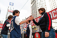 Former women's national team players Michelle Akers and April Heinrichs celebrate at the end of the game during the centennial celebration of U. S. Soccer at Times Square in New York, NY, on April 04, 2013.