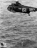 Astronaut M. Scott Carpenter is lifted by cable into a hovering United States Navy helicopter during the recovery operation after his three orbit flight on May 24, 1962.<br /> Credit: NASA via CNP