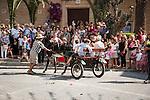 Donkey-drawn cart in a street parade, during the fiesta: Mare de Déu de la Salut, Sant Lloranc, Mallorca