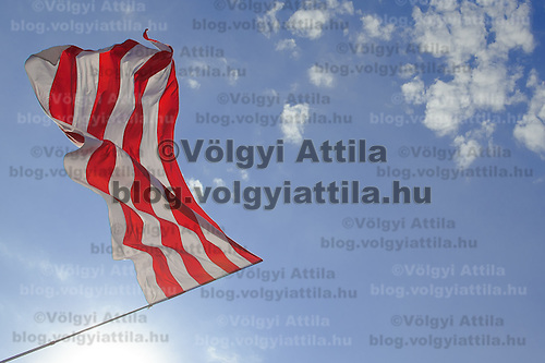Flag weaves during a political gathering of Hungarian far-right political party Jobbik to celebrate the fourth anniversary of their paramilitary group Hungarian Guard (or Magyar Garda in Hungarian) in Budapest, Hungary on August 28, 2011. ATTILA VOLGYI