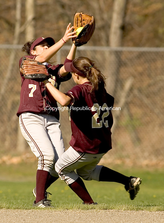 WATERBURY, CT--04 MAY 2007--050407JS08-Sacred Heart's Allyse Bamonte (7) and Kelsey Dunn (22) nearly collide while going for a pop fly during their game against Crosby Friday at Municipal Stadium in Waterbury.<br /> Jim Shannon/Republican-American