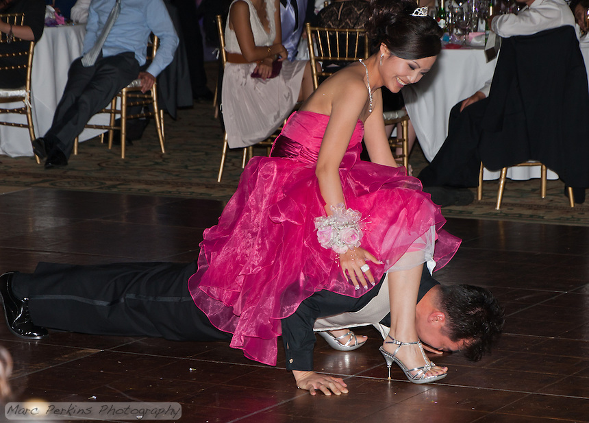 The DJ seemed like a personal trainer in disguise.  He had Eucen do pushups with Jia on his back.  I strongly suspect she helped him: note her foot position here.