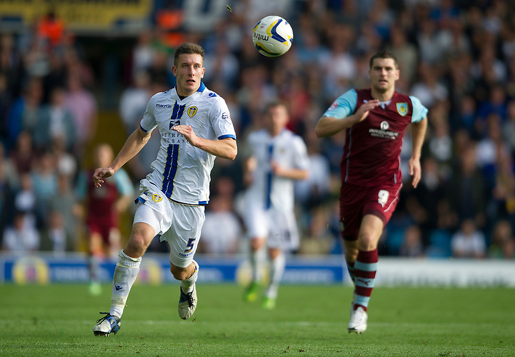 Leeds United's Jason Pearce chased by Burnley's Sam Vokes<br /> <br /> Photo by Stephen White/CameraSport<br /> <br /> Football - The Football League Sky Bet Championship - Leeds United v Burnley - Saturday 21st September 2013 - Elland Road - Leeds<br /> <br /> &copy; CameraSport - 43 Linden Ave. Countesthorpe. Leicester. England. LE8 5PG - Tel: +44 (0) 116 277 4147 - admin@camerasport.com - www.camerasport.com