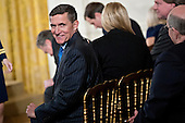 """Retired Lieutenant General Michael Flynn, U.S. national security advisor, attends a swearing in ceremony of White House senior staff in the East Room of the White House in Washington, D.C., U.S., on Sunday, Jan. 22, 2017. Trump earlier today mocked protesters who gathered for large demonstrations across the U.S. and the world on Saturday to signal discontent with his leadership, but later offered a more conciliatory tone, saying he recognized such marches as a """"hallmark of our democracy."""" <br /> Credit: Andrew Harrer / Pool via CNP"""