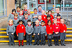 Mr Andrew O'Sullivan with his junior infant class in Holy Cross/Mercy NS on their first day at school on Monday