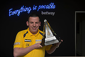20.05.2015. London,  England. Betway Premier League Darts, Play-Offs Media Day. [L-R] Dave Chisnall with the Betway Premier League Trophy.