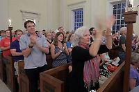 The crowd cheers for featured speaker Dr. Cornel West during a Mass Prayer Service Friday at St. Paul's Memorial in Charlottesville, Va. Photo/Andrew Shurtleff