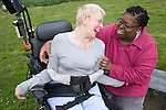 Woman with Cerebral Palsy sharing a joke with her carer. MR