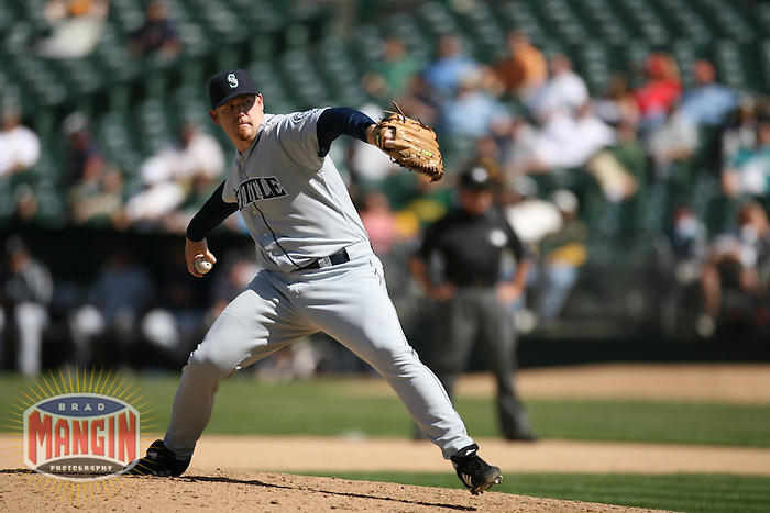 OAKLAND, CA - April 26:  J.J. Putz of the Seattle Mariners pitches during the game against the Oakland Athletics at the McAfee Coliseum in Oakland, California on April 26, 2007.  The Mariners defeated the Athletics 4-2.  Photo by Brad Mangin