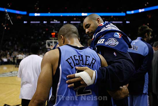 San Antonio - Utah Jazz forward Carlos Boozer (5) puts his arm around teammate Utah Jazz guard Derek Fisher (2) and shares a short conversation in the 4th quarter. Utah Jazz vs. San Antonio Spurs, Western Conference Finals game five at the AT&T Center..5.30.2007