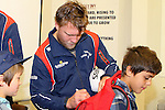 NELSON, NEW ZEALAND - July 26: Ross Geldenhyus signs a fan's shirt during the Tasman Makos Family Fun Day at TRU Players Room, Trafalgar Park July 26, 2015 in Nelson, New Zealand. (Photo by Marc Palmano/Shuttersport Limited)