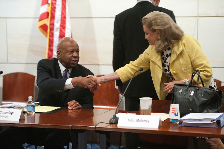 "UNITED STATES - JUNE 30: Oversight and Government Reform Committee ranking Democrat Rep. Elijah Cummings, D-Md. greets Carolyn Maloney, D-NY., during the  House Oversight and Government Reform Committee Democrats hold a forum on ""Law Enforcement Tools to Stop the Flood of Illegal Weapons"" on both sides of the U.S.-Mexico border. (Photo By Douglas Graham/Roll Call)"