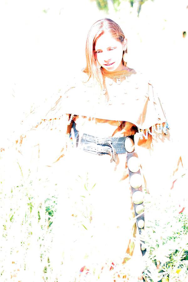 A young Native American Indian teenager girl walking along a rivers edge in South Dakota greifenhagen