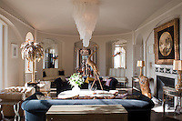 A symmetry is achieved in the drawing room with a pair of leather banquettes in mirrored alcoves either side of a doorway leading into the dining room