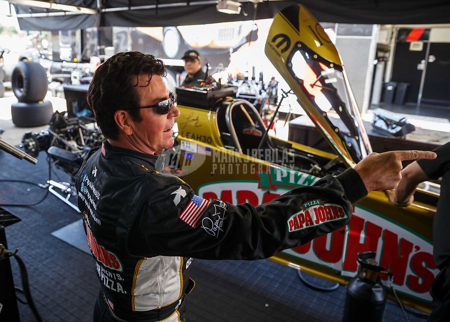Jul 8, 2017; Joliet, IL, USA; Papa Johns Pizza founder John Schnatter in the pit area of NHRA top fuel driver Leah Pritchett during qualifying for the Route 66 Nationals at Route 66 Raceway. Mandatory Credit: Mark J. Rebilas-USA TODAY Sports