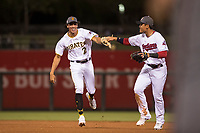 AFL West shortstop Cole Tucker (2), of the Surprise Saguaros and the Pittsburgh Pirates organization, is congratulated by Yu Chang (9), of the Glendale Desert Dogs and Cleveland Indians organization, after a third out during the Fall Stars game at Surprise Stadium on November 3, 2018 in Surprise, Arizona. The AFL West defeated the AFL East 7-6 . (Zachary Lucy/Four Seam Images)