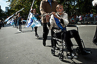 a disabled woman takes part during the Annual Columbus Day Parade in New York,  October 14, 2013, Photo by Kena Betancur / VIEWpress.