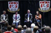 INDIANAPOLIS, IN - January 18, 2013: 1999 World Cup captain Julie Foudy (right) talks as (from right) 1991 World Cup coach Anson Dorrance, 1991 World captain and 2003 World Cup coach April Heinrichs, and 1995 and 1999 coach Tony DiCicco listen. U.S. Soccer hosted a World Cup Coaches and Captains panel at the Indiana Convention Center in Indianapolis, Indiana during the NSCAA Annual Convention.