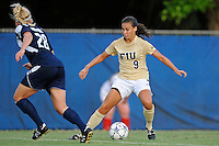 27 August 2011:  FIU's Ashleigh Shim (9) attempts to get around Akron's Liz Cloutier (28) in the first half as the FIU Golden Panthers defeated the University of Arkon Zips, 1-0, at University Park Stadium in Miami, Florida.