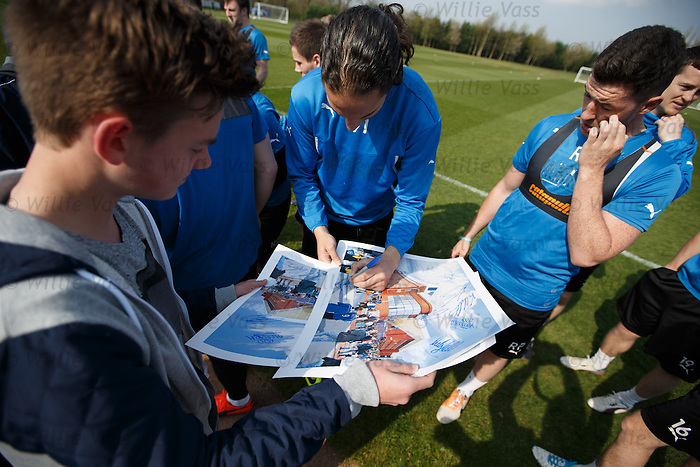 Bilel Mohsni signs for some young fans at the training ground this morning