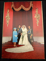 BNPS.co.uk (01202 558833)<br /> Pic: MooreAllen&amp;Innocent/BNPS<br /> <br /> The Queen and Prince Philip's 1981 card, which shows Charles and Diana's wedding.<br /> <br /> A comprehensive collection of Christmas cards sent by the Queen and Prince Philip over a 30 year period have emerged to highlight the fascinating changes of the Royal Family.<br /> <br /> The 31 greetings cards carry various images of the Royal couple on the front along with different members of their family.<br /> <br /> They were sent every year without fail from 1971 through to 2001 to the unnamed recipient, who was clearly an acquaintance of the Queen.<br /> <br /> The first card features a formal photograph of the Queen, the Duke of Edinburgh, a 23-year-old Prince Charles, Princess Anne, Prince Andrew, aged 11 and seven-year-old Prince Edward.<br /> <br /> They are being sold in Cirencester on Friday.