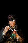 California Red-legged Frog (Rana draytonii) biologist, Valentine Hemingway, swabbing female frog for chytrid fungus, Elkhorn Slough, Monterey Bay, California