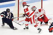 Kelly Horan (UConn - 21), Kathryn Miller (BU - 4), Braly Hiller (BU - 31) - The Boston University Terriers defeated the visiting University of Connecticut Huskies 4-2 on Saturday, November 19, 2011, at Walter Brown Arena in Boston, Massachusetts.