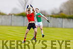 High fielding action from Andrew Barry of Na Gaeil and Colin Mc Gillicuddy of  Glenbeigh-Glencar in Division 2 of the County Football league on Sunday