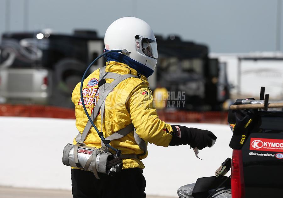 Apr. 28, 2013; Baytown, TX, USA: NHRA Safety Safari crew during the Spring Nationals at Royal Purple Raceway. Mandatory Credit: Mark J. Rebilas-