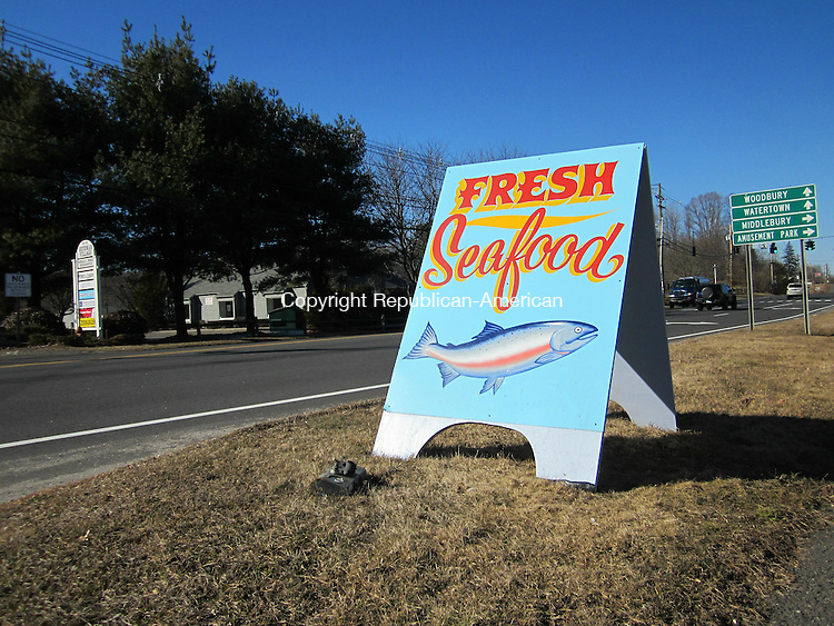 WOODBURY, CT - 9 Feb 2012 - 020912RH03 - A sign advertises a seafood truck on Main Street South in Woodbury. The Board of Selectman has called for the Zoning Commission to issue a one-year moritorium on permits for vendor trucks in town. Rick Harrison Republican-American