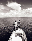 USA, Florida, two men standing on a boat fishing, Ivory Keys (B&W)