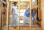 John Umphress, right, a conservation program specialist with Austin Energy, points out an area where a sub contractor missed applying a piece of therma ply behind a bath tub to Brian Domino, building superintendent for Standard Pacific Homes, on Monday, June 15, 2009 in Austin, Texas. ..