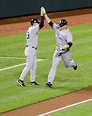 New York Yankees first baseman Lyle Overbay (55) celebrates his seventh inning home run with third base coach Rob Thomson (59) against the Baltimore Orioles at Oriole Park at Camden Yards in Baltimore, Maryland on Monday, May 20, 2013.  The Yankees won the game 6 - 4..Credit: Ron Sachs / CNP.(RESTRICTION: NO New York or New Jersey Newspapers or newspapers within a 75 mile radius of New York City)