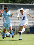Lauren Tippets (12), of Duke, sends a shot past San Diego's Nicole Carriaga (6) on Sunday September 18th, 2005 at Koskinen Stadium in Durham, North Carolina. The Duke University Blue Devils defeated the University of San Diego Toreros 5-0 during the Duke adidas Classic soccer tournament.