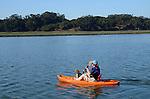 Woman kayaking at Elkhorn Slough with dog