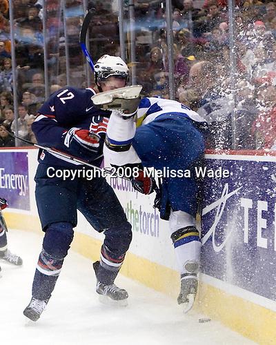 Jimmy Hayes (USA - 12), Dmitri Tikhonov (Kazakhstan - 4) - The US defeated Kazakhstan 12-0 on Tuesday, December 30, 2008, at Scotiabank Place in Kanata (Ottawa), Ontario during the 2009 World Junior Championship.
