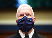 Assistant Secretary for Health U.S. Department of Health and Human Services ADM Brett P. Giroir wears a face mask while he waits to testify before the House Committee on Energy and Commerce on the Trump Administration's Response to the COVID-19 Pandemic, on Capitol Hill in Washington, DC on Tuesday, June 23, 2020.  <br /> Credit: Kevin Dietsch / Pool via CNP