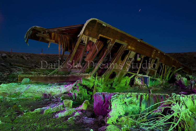 Little remains of an abandoned trailer house slowly sinking into the salty mud at a flooded neighborhood in Bombay Beach, California on the shore of the Salton Sea