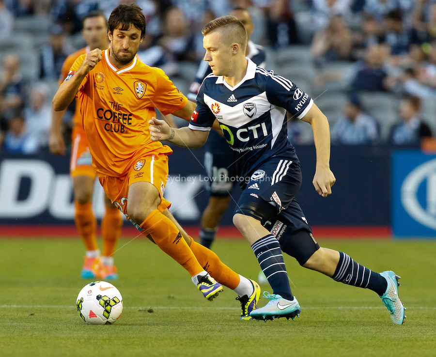 Scott GALLOWAY of the Victory controls the ball in the round seven match between Melbourne Victory and Brisbane Roar in the Australian Hyundai A-League 2014-15 season at Etihad Stadium, Melbourne, Australia.